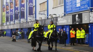 Mounted police patrolled outside the stadium before the Everton and Sunderland match at Goodison Park earlier