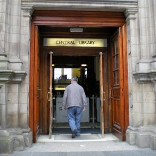 Man walking into Central Library in Edinburgh