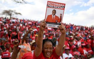 A Botswana Democratic Party (BDP) supporter holds up a poster during an election campaign rally in Mokgweetsi Masisi's, President of Botswana and leader of the BDP, home village in Moshupa, on October 22, 2019.