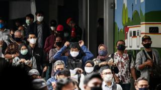People wearing masks in the Indonesia capital Jakarta