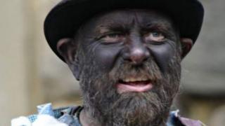 Blacked-faced Morris dancers