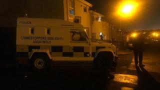 Police at scene of Velsehda court in ardoyne