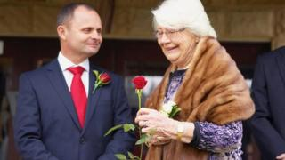 Andrew (left) and his mother, Helen, (right) at his wedding