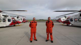 Inverness crew members with the new AW189s front and the S92s in the background
