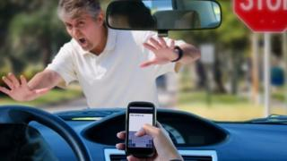 Driver on mobile phone nearly running someone over