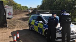Police at salvage yard