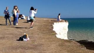 Tourist at cliff edge