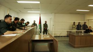 Palestinian military court judges oversee the trial of three men accused of murder in Gaza (19 November 2007)