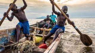 Kenyan boys and fishermen on Lake Victoria