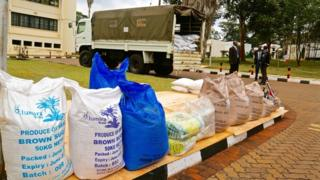 Bags of impounded sugar with truck in background