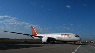 An Air India plane parked on airport tarmac