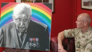 Lt Col Rich Hall admires the portrait after the presentation.
