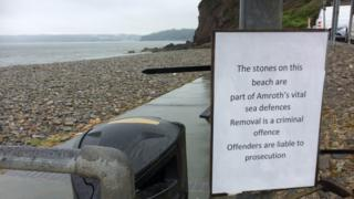 The sign warning people they could be prosecuted for removing stones from Amroth beach