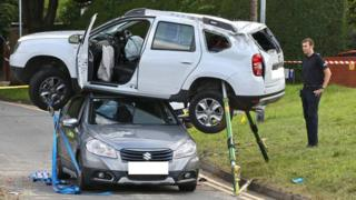 A white Dacia Duster on top of a grey Suzuki after a crash on Barrack Hill, Newport