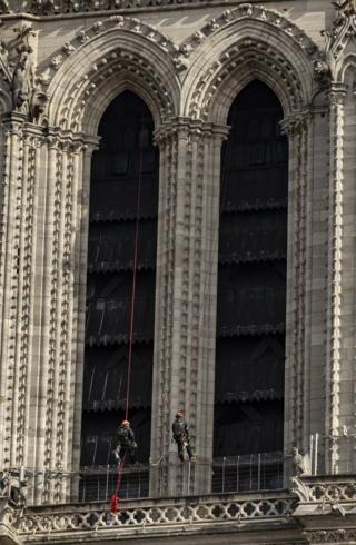 Workers are seen restoring the Notre-Dame cathedral