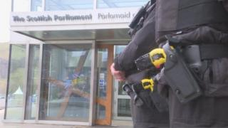 Police outside parliament with Tasers