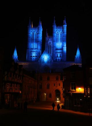 Lincoln Cathedral lit up in blue