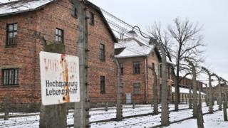 The barbed wire and buildings at the former Auschwitz concentration camp
