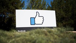 This file photo taken on November 4, 2016 shows the Facebook Thumbs Up sign and logo in Menlo Park, California.