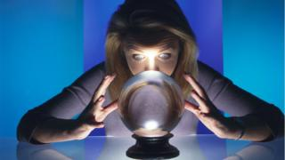 Magician staring into a crystal ball