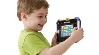 A child using a Vtech toy