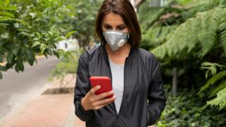 Technology Woman in mask on app