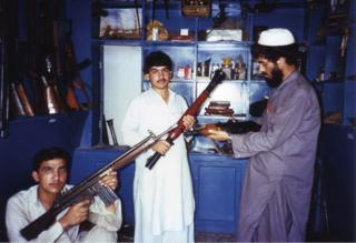 Members of the Mujahideen holding guns in Afghanistan in 1988
