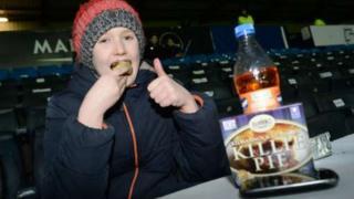 Young fan eats Killie Pie