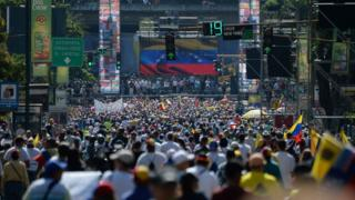 "Opposition activists pour to the streets to back Venezuelan opposition leader Juan Guaido""s calls for early elections, in Caracas on February 2, 2019"