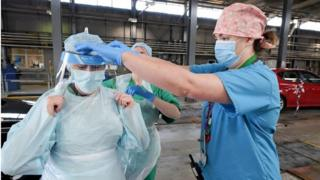 environment Health workers putting on PPE