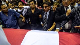 Mourners at Garcia's funeral