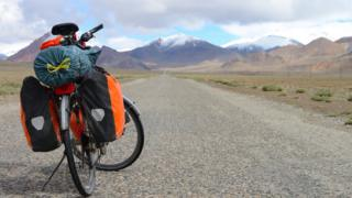 Long distance cycling on M41 Pamir Highway, Pamir Mountain Range, Tajikistan. File image