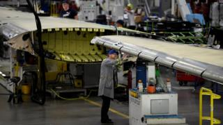 Workers at the Bombardier plant assemble wings for C-Series planes