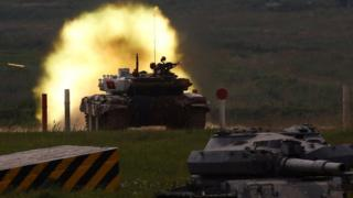 A T-72 tank, operated by a crew from Angola, fires at a target during the Tank Biathlon competition, part of the International Army Games 2017, at a range in the settlement of Alabino outside Moscow, Russia, July 29, 2017