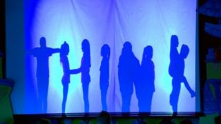 "Silhouetted children form the word ""Think"""