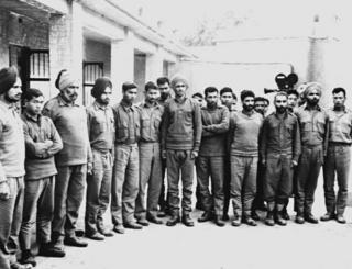 A group of Indian soldiers captured by Pakistani army pose for a photographer in a POW camp in December 1971 during the India-Pakistan border conflict