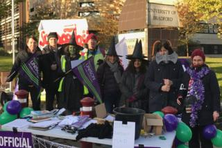 People dressed in Halloween costumes on a picket line