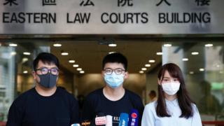 Pro-democracy activists Ivan Lam, Joshua Wong and Agnes Chow arrive at the Eastern Court for a hearing in Hong Kong, China July 6, 2020