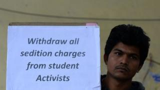 An Indian student holds a placard during a protest against the arrest of the president of Jawaharlal Nehru University's Student Union (JNU) Kanhaiya Kumar