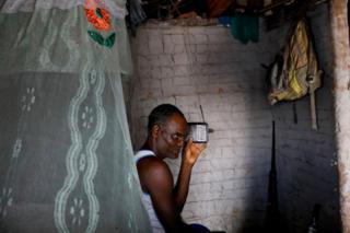 Fisherman Jose da Cruz listening to his radio