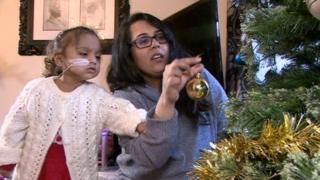 Anaya Kandola and her mum, Joety, decorate the family Christmas tree