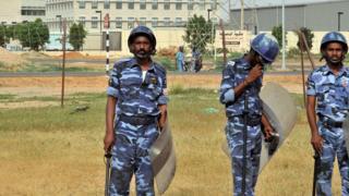 Three Sudan policemen stand dey look