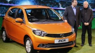 "Chairman of Tata Group, Cyrus Mistry and Tata Motors"" Head of Advanced and Product Engineering, Tim Leverton (R), pose with a Zica car during its launch at the Indian Auto Expo in Greater Noida, on the outskirts of New Delhi, India, February 3, 2016."