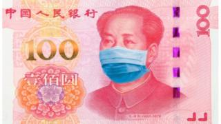 Chinese bill with a surgical mask on the effigy of Mao Zedong