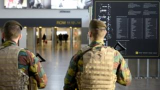 Belgian police forces take part in an operation in Brussels' Zaventem airport, 18 November