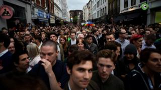 People gather in Soho, London