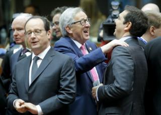 French President Francois Hollande looks on while EU Commission President Jean-Claude Juncker jokes with Greek Prime Minister Alexis Tsipras
