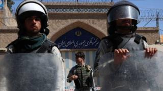 Afghan riot police stand guard outside the Iranian consulate during a protest against the Iranian regime and demand justice for the Afghans allegedly killed by the Iranian security forces, in Herat, Afghanistan, 11 May 2020