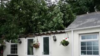 Couple row with council after branch crashes though roof