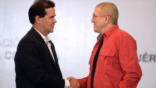 The head negotiators of the Colombian government and the country's ELN left-wing guerrilla, Frank Pearl (L) and Antonio Garcia respectively, shake hands as they begin peace negotiations at the Foreign Ministry in Caracas on March 30, 2016.